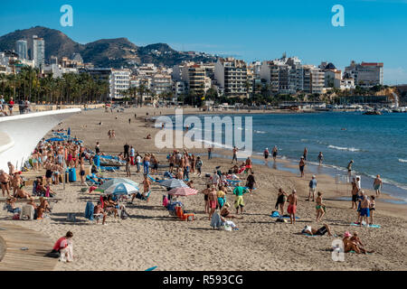 Benidorm, Costa Blanca, Spain, 29th November 2018. Sunbathers and swimmers enjoy the sun on Poniente beach. Average temperatures over 17 degrees Celsius through the winter months make the Costa Blanca an ideal destination for cold and wet Brits. Pensioners and seniors can be seen here exercising to music on the beach. Credit: Mick Flynn/Alamy Live News - Stock Image