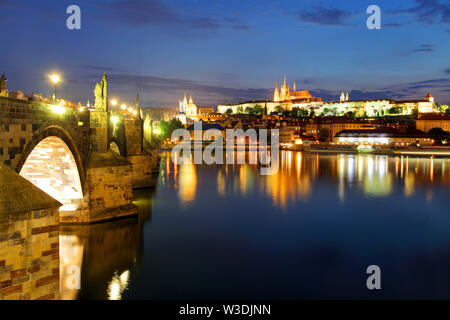 Prague castle and Charles bridge at night - Stock Image