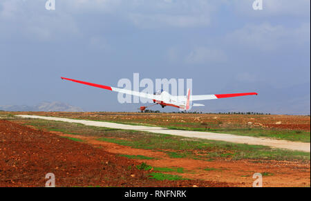 ASK13 glider of the Cyprus Gliding group taking off on a winch launch at Mammari airfield, Nicosia, Cyprus October 2018 - Stock Image