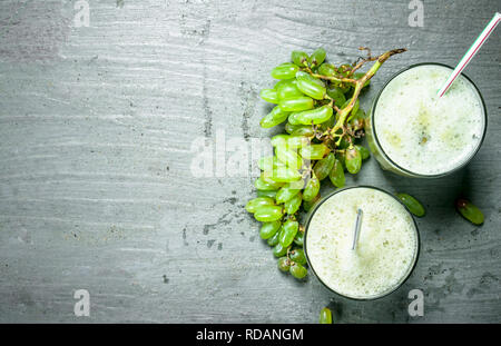 Green smoothie with grapes . On rustic background. - Stock Image