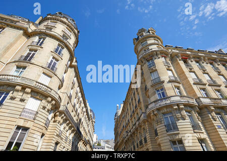 PARIS, FRANCE - JULY 21, 2017: Ancient luxury buildings facade with tower in a sunny summer day in Paris, France - Stock Image