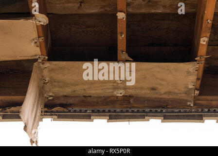 Water damaged roof after ceiling has fallen away in need of repair - Stock Image