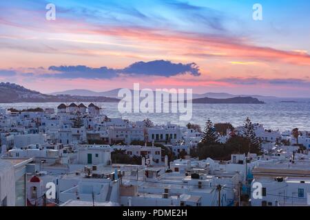 Traditional white windmills at sunset, Mykonos, Greece - Stock Image