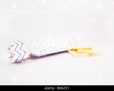 Christmas Decoration with white cracker box with golden bokeh and snow for holidays best background image for Holiday - Stock Image