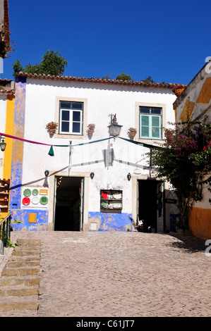 Shop front in the medieval town of Obidos some 50 miles north of Lisbon, Portugal - Stock Image