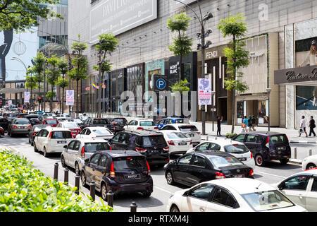 Sunday Afternoon Traffic on Jalan Bukit Bintang, Pavilion Mall on right. Kuala Lumpur, Malaysia. - Stock Image
