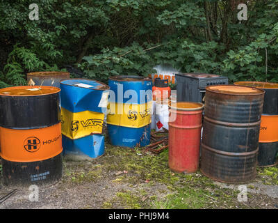 Empty industrial lubricant steel barrels awaiting disposal. - Stock Image
