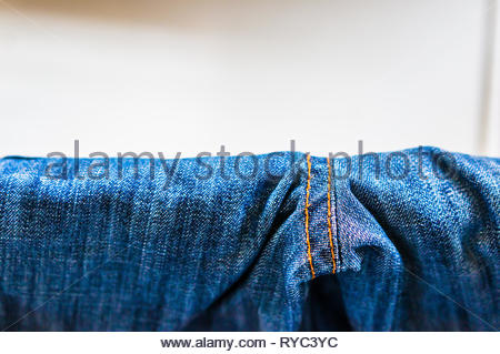 Close up of drying blue jeans pants. - Stock Image