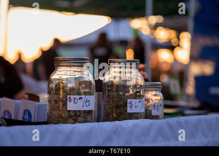 VANCOUVER, BC, CANADA - APR 20, 2019: Close-up of jars of marijuana being sold by a vendor at the 420 festival in Vancouver. - Stock Image