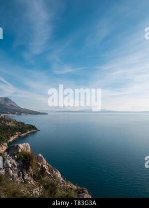 Calm blue sea and rocky coastline landscape on Makarska riviera in Croatia - Stock Image
