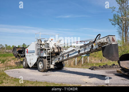 Roadtec SB 2500e material transfer vehicle used in road construction and repaving or asphalt paving in Montgomery Alabama, USA. - Stock Image