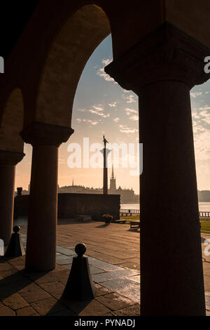 View from Stockholm City Hall courtyard with early morning light, looking towards Riddarholmen Island, Kungsholmen, Stockholm, Sweden. - Stock Image