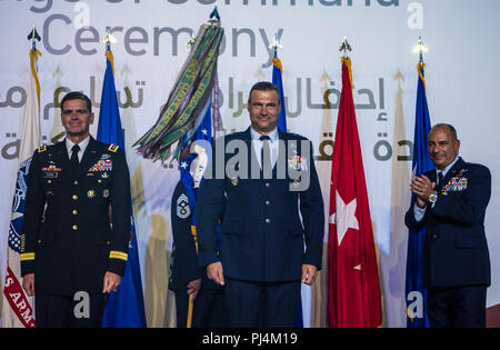 U.S. Army Gen. Joseph L. Votel, Commander of U.S. Central Command (CENTCOM), stands with U.S. Air Force Lt. Gen. Joseph T. Guastella Jr., Commander of U.S. Air Forces Central Command (AFCENT), and Air Force Lt. Gen. Jeffrey L. Harrigian, outgoing AFCENT commander, during a change of command ceremony at Al Udeid Air Base, Qatar, Aug. 30, 2018. Guastella entered the Air Force in 1987 as a graduate of the U.S. Air Force Academy. He has flown the F-16 Fighting Falcon and A-10 Thunderbolt II, served as the wing commander of the 455th Air Expeditionary Wing at Bagram Airfield, Afghanistan, has had m - Stock Image