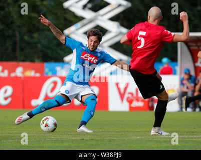 Stadium Carciato, Dimaro, Italy. 13th July, 2019. Pre-season football freindly, Napoli versus Benevento; Simone Verdi of Napoli gets his shot towards goal past Luca Antei of Benevento Credit: Action Plus Sports/Alamy Live News - Stock Image