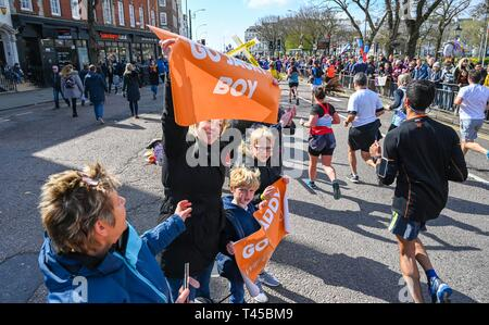 Brighton, Sussex, UK. 14th Apr, 2019. Thousands of runners and spectators taking part in this years Brighton Marathon which is celebrating its 10th anniversary Credit: Simon Dack/Alamy Live News - Stock Image