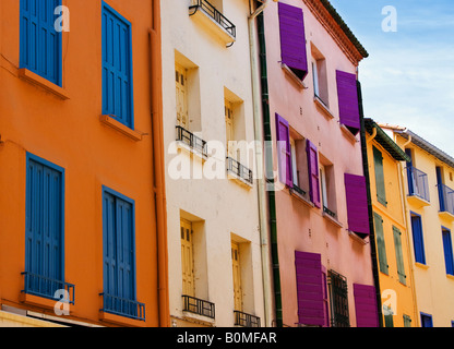Colorful wood shutters on the quaint charming buildings in the seaport village of Collioure France - Stock Image