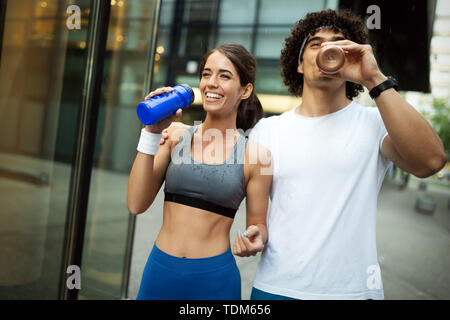 Young fit couple have training in urban enviroment at sunny day - Stock Image