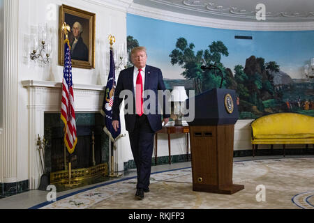 US President Donald Trump leaves the room after delivering remarks in the Diplomatic Reception Room of the White House in Washington, D.C. on January 19, 2019. Trump spoke about a new plan to secure the US border and re-open the US Government which remains shutdown. - Stock Image