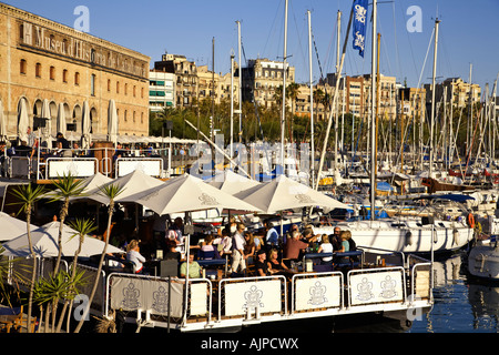 Barcelona Port Vell Bar terasse on deck of a boat in front of Museu d Historia de Catalunya - Stock Image