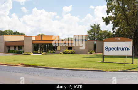 HICKORY, NC, USA-9/6/18:  Front lawn, building and road sign of a local Spectrum building, formerly Charter, a cable, internet and telephone provider. - Stock Image