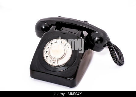 A vintage plastic black rotary dial-up telehone handset, probably from the seventies - Stock Image