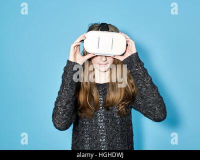 Girl 12- 14yo wearing virtual reality VR Glasses - Stock Image