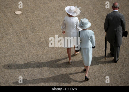 The Prince of Wales, the Duchess of Cornwall and the Princess Royal during a garden party at Buckingham Palace in London. - Stock Image
