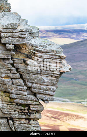 Rock layers smoothed by years of weathering are seen near the summit of Pen-y-Ghent in the Peak District, England. - Stock Image