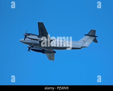 M-JACK a Beechcraft Super King Air B200GT leaving Inverness Dalcross airfield in the Scottish Highlands. - Stock Image