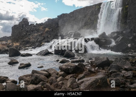 Large rocks and waterfall - Stock Image