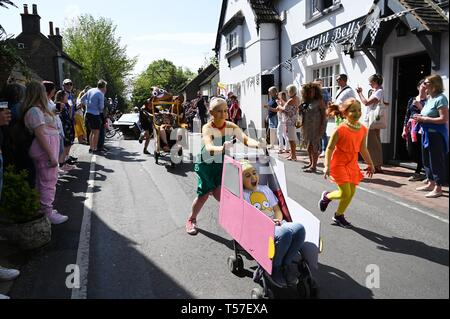 Bolney Sussex, UK. 22nd Apr, 2019. The children's race in the annual Bolney Pram Race in hot sunny weather . The annual races start and finish at the Eight Bells Pub in the village every Easter Bank Holiday Monday Credit: Simon Dack/Alamy Live News - Stock Image
