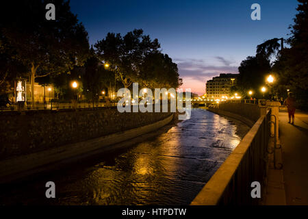Granada Spain River Genil at night meandering through Plaza de Humillaredo - Stock Image