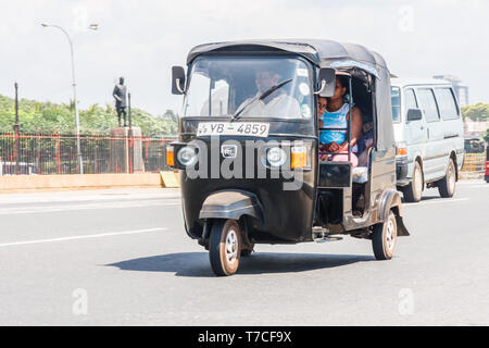 Colombo, Sri Lanka - March 16th 2011: A tuk tuk carrying passengers. This is a cheap way of getting around the city. - Stock Image