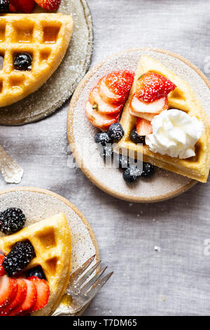 Gluten-free Paleo Waffle with Berries and Maple Syrup. - Stock Image