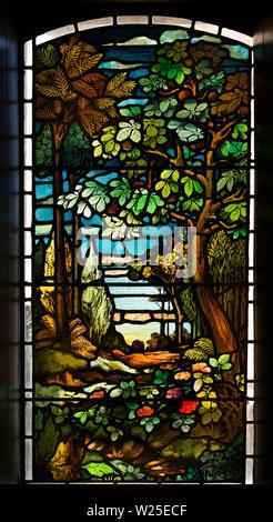 UK, Cumbria, Sedbergh, Marthwaite, St Gregory's church window, depicting naturalistic woodland scene - Stock Image