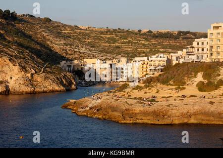 The seaside village of Xlendi (pronounced Shlendy) in Gozo, Malta, at sunset - Stock Image