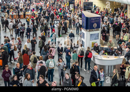 Large Crowds,Rail Passengers,Kings Cross Station,Concourse,London,England - Stock Image