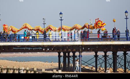 Eastbourne, UK. 17th Feb 2019. A Chinese dragon lines Eastbourne pier as part of todays Chinese New Year celebrations. East Sussex.  Credit: Ed Brown/Alamy Live News - Stock Image