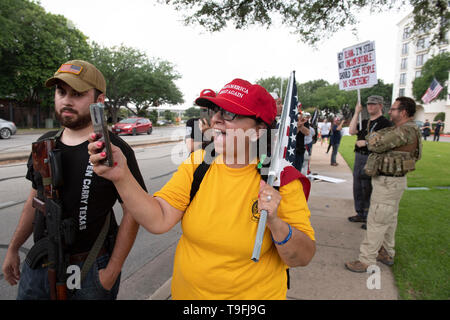 Protesters, some opening carrying guns legally, rally outside Austin, Texas, hotel where controversial Muslim Congresswoman Ilhan Omar spoke at a city-wide iftar dinner. Omar has been accused of making anti-Semitic remarks. - Stock Image