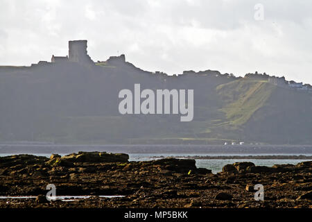 Scarborough's Castle and headland towering above Marine Drive and North Bay, seen from across the bay at Crook Ness. - Stock Image
