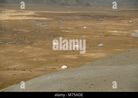 Gers (yurts) dot the landscape of nomadic Kazakh herders in the Altai Mountains of western Mongolia. - Stock Image