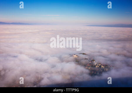 Scenic view of cloudscape over city - Stock Image