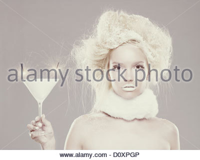 Ice maiden holding cocktail with sparklers - Stock Image