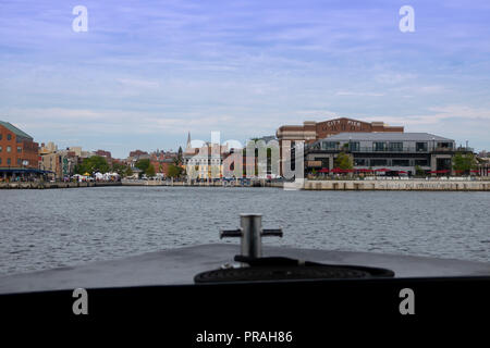 USA Maryland MD Fells Point a water taxi approaches the dock in the historic neighborhood  The Sagamore Pendry Hotel is at the old City Pier - Stock Image
