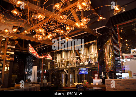 Amsterdam Brewhouse brewery tanks and lights above bar a Toronto Harbourfront restaurant bar - Stock Image