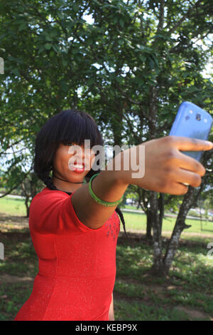 Lady with Smartphone outdoors - Stock Image