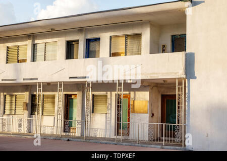 Miami Beach Florida North Beach vacant abandoned condemned motel hotel apartment building blighted property jalousie windows boarded up - Stock Image