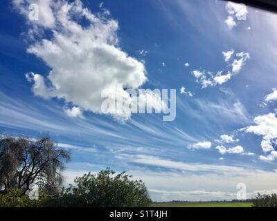 Blue sky epic clouds - Stock Image