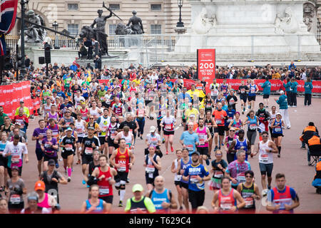 London, UK. 28th April 2019.London Marathon runners after having crossed the finish line, collected their medals and head off to get their bags in The Mall.Credit: Keith Larby/Alamy Live News - Stock Image