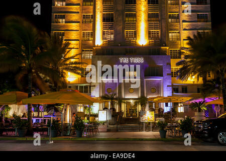 The neon illuminated Art Deco facade of the Tides hotel and terrace dining on Deco Drive in Miami's South Beach, - Stock Image